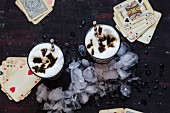 Iced coffee with caramel and playing cards