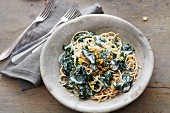 Vegan kamut spaghetti with lemons, spinach and oat cream