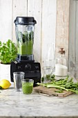 A green smoothie being made in a blender