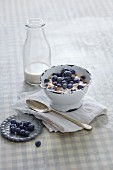 Vegan power muesli with blueberries and almond milk
