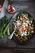 Vegan salad with kale, white beans and pomegranate seeds