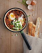Aubergine shakshuka with poached eggs and unleavened bread