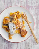 Fruity couscous hash with icing sugar