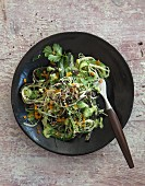 Vegan cucumber and avocado salad with algae pasta