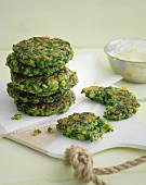 Green spinach fritters with a lemon dip