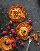 Vegan sweet potato pancakes with apples and maple syrup