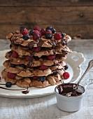 Vegan waffles with fresh berries and chocolate sauce