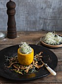 Yellow courgettes filled with tahini and orange cream on marinated shiitake mushrooms