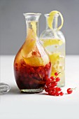 Homemade redcurrant and ginger liqueur and ginger and lemon liqueur