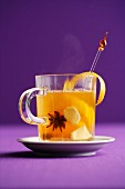 Homemade ginger punch with white wine, oranges and star anise