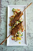 Lamb skewers in a ginger and chilli coating with a warm couscous salad