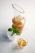 Homemade lemon iced tea with fresh ginger
