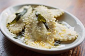 Ricotta-filled ravioli with Parmesan cheese, fried sage and sea salt