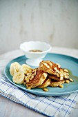 Mini banana pancakes with maple syrup