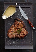 Grilled T-bone steak with gravy