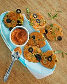 Mediterranean olive and buckwheat blinis with tomato spread
