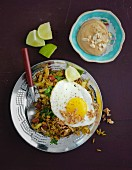 Vegetarian nasi goreng with egg and peanut sauce (Indonesia)