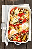 Eggs baked with vegetables (potatoes, courgette, mushrooms, pepper)