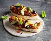 Bruschetta with fresh chanterelles, artichokes and olives