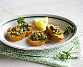Crostini with green olive and anchovy cream