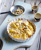 Gratinated peaches with Amaretto and flaked almonds