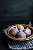 Fresh figs in a ceramic bowl