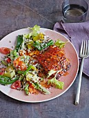 Creole salmon with wild rice and colourful vegetables