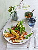 King trumpet mushroom piccata on a bed of salad with vegetable vinaigrette