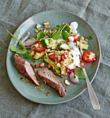 Spicy lamb fillet with bulgur salad and purslane