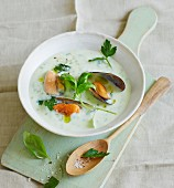 Cream of potato soup with celery and fresh mussels