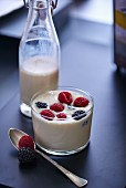 A vanilla smoothies with red berries