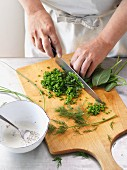 Fresh herbs being sliced
