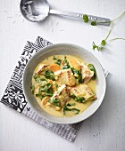 Quick coconut fish curry with spinach and carrots (Asia)