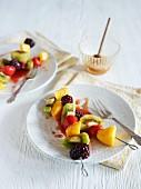 Fruit skewers with honey sauce