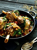 Knuckle of lamb in a curry sauce with spinach and chickpeas
