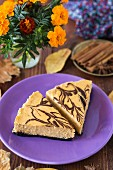 Two slices of pumpkin cheesecake with chocolate