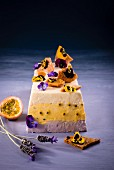 White chocolate mousse cake with lavender, passion fruit, honeycomb and pansies