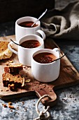 Hot chocolate and cake on a chopping board