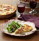 Quiche Lorraine with a mixed leaf salad and red wine