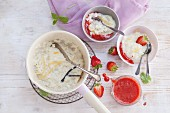 Rice pudding with lemon zest and strawberry sauce