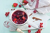 Homemade red berry compote with cinnamon