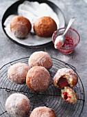 Homemade mini doughnuts filled with raspberry jam