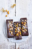 Gluten-free cocoa cake with physalis, banana and mango