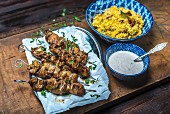 Grilled chicken kebab with a yoghurt sauce and rice