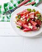 Watermelon salad with Parma ham, feta and balsamic vinegar dressing