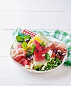 A watermelon salad with Parma ham, feta and balsamic vinegar dressing