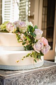 A two-layered cake with romantic rose decoration