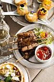 Teriyaki beef skewers with plum tomato chilli chutney