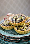 Belgian chocolate tarts with pistachios