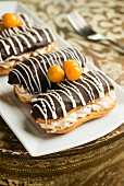 Chocolate eclairs decorated with physalis